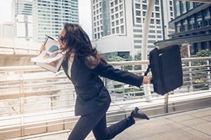 A businesswoman rushing to a meeting with translations of a project report